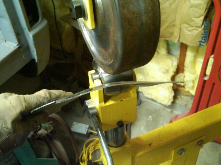 English wheel working the metal
