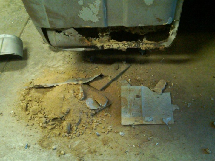 Cab corner cut out... lots of dirt and sand!