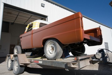loading up 66 custom F100 truck on trailer