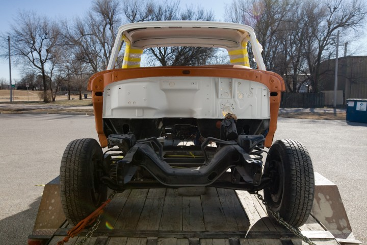 Front view of a 66 custom, loading up truck on trailer